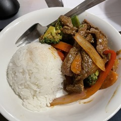 White bowl containing a mound of white rice and Hoisin Beef Stir-fry